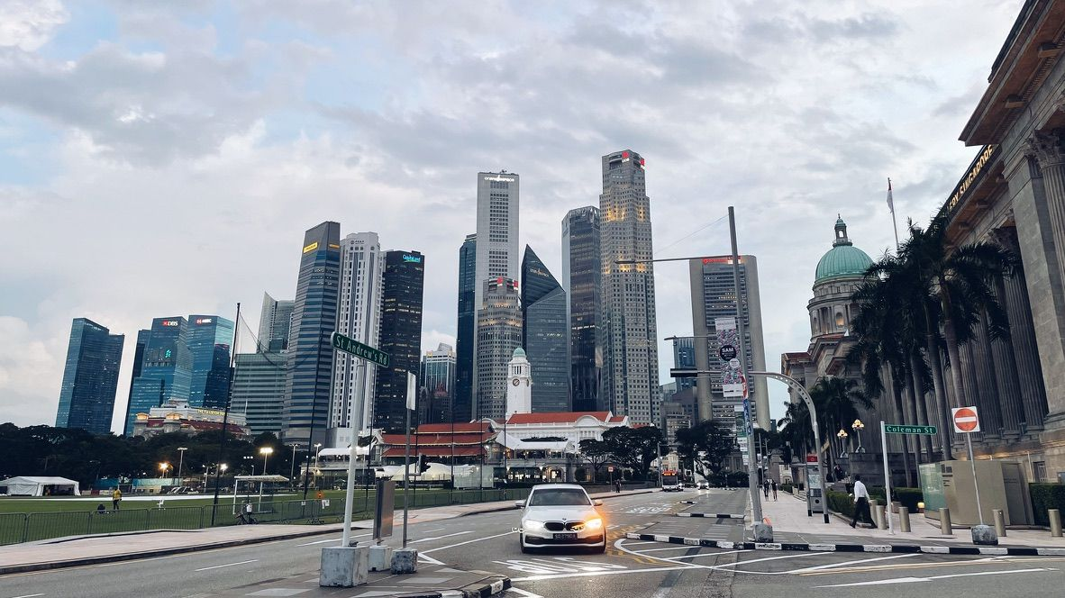 Singapore's civic district, with a skyline of skyscrapers in the background.
